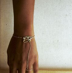 A beautiful 14k gold filled wristlet w/ 1.25 brass Eye of Heru charm.    Please select your wrist size below, and >>>provide your RING size, as well
