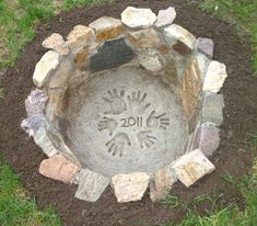Homemade fire pit with family handprints