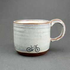 Variety of small and larger mugs. Nothing too massive, but handmade ceramic! Check out Jude Bryant's ceramics in VT too. Blue Ceramic Mountain Bike Mug by JuliaSmithCeramics on Etsy Ceramic Cups, Ceramic Art, Ceramic Design, Pottery Mugs, Ceramic Pottery, Crackpot Café, Sculptures Céramiques, Pottery Designs, Cute Mugs