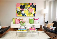 Alexandra Heitz's apartment. Crazy about that art and the bright colors.