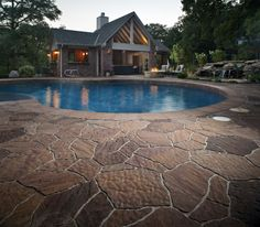 Belgard Mega-Arbel Pool Deck YORKTOWN MATERIALS PINTEREST INSPIRATION Mega-Arbel® Patio Slab gives homeowners the perfectly integrated, natural-looking hardscapes they desire. Its scale is similar to natural flagstone. With its irregular shape and textured surface, Mega-Arbel creates outdoor spaces that flow harmoniously into the surrounding landscape.