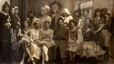 """Cross-dressing guests for a gay wedding in Petrograd 1921. The """"wedding"""" had actually been organized by a secret police officer who arrested all the attendees at the end of the ceremony but the charges were eventually dropped. [2048x1152]"""
