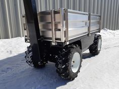 This All-Terrain Electric Cart is equipped with aluminum removable sides to keep the payload secure. Standard features are black color and SuperLug tires. Motorized Wheelbarrow, Powered Wheelbarrow, Electric Wheelbarrow, Electric Utility, Go Kart, Pug, Cart, Landscaping, Platform