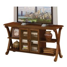 3-tier media console with x-shaped legs and a center storage cabinet.   Product: Media consoleConstruction Materia...