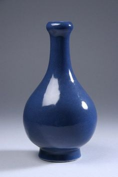 CHINESE POWDER BLUE PORCELAIN VASE, Qing Dynasty, 19th century. Of pear-shape with garlic mouth - 9 in. high.