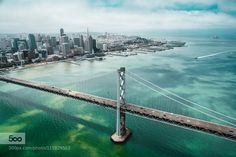 SF From the Sky - Pinned by Mak Khalaf Shot this from a helicopter flying over the Bay Bridge. The sun was peeking through the clouds to create an awesome texture on the water. City and Architecture SFaerialbeautifulbluecitycloudscolorhelicopteroceanskytravelwaterSFonair by connorsurdi