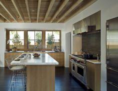 exposed blonde rafters + marble counter + steel appliances + dark wood floor = glorious