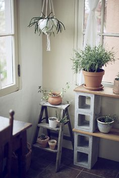I love these shelves made from planks of wood and cement blocks! - I want to make all my things!