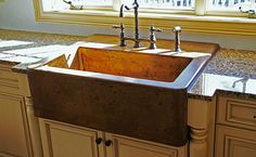 Apron Front Sink – also known as a farm or farmhouse sink.  These sinks have a large apron in front and sit on a short cabinet.  The countertop wraps around these sinks on the sides and back edge only – not in the front