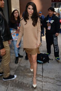 Selena stays warm and chic in a comfy turtleneck sweater and matching skirt.