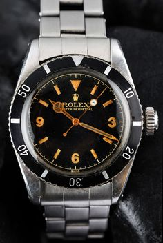 Image from https://4.bp.blogspot.com/-8_WGzpZBp2s/TrGzUdpTwRI/AAAAAAAALn4/5GY8rTq4f8Y/s1600/Rolex-Submariner-Reference-6200-3-6-9-Dial.jpg.