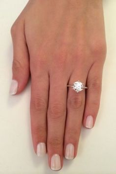 $3500 - thin white gold band, 6 prong setting, 2 ct - can search for relisted item/in other items by seller. Buy direct from ebay.