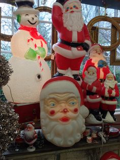 Vintage blow mold Christmas decorations.  Santa is all lit-up for the holiday.