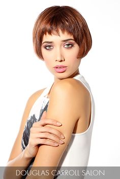 This sassy short cut gets a jolt from the dark chestnut hue and copper accents as they play off of each other for an electric effect.