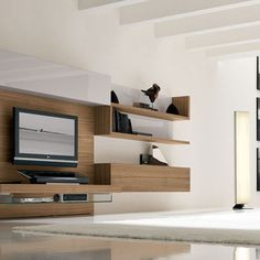 Replace the TV with a fireplace? like the built-ins adjacent