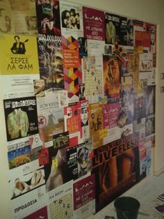 Wall covered with street posters and atlacol.