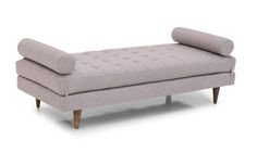 Form and function, practical and pretty. However you phrase it, all you need to know is that the handcrafted Eliot daybed arrives at the crossroads of retro, Mid-century bones and present day appeal. Make the already unique design more so in a statement-making color or a refined neutral hue. Detachable bolsters that double as headrests and a button-tufted cushion bed add character to Eliot's chameleon-like identity as both a bench and a cozy bed.