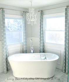 Reader Redesign | Young House Love - love love love the chandy above the tub