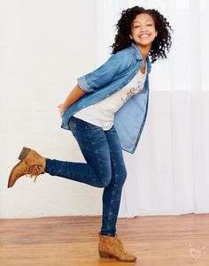 Pair medium wash jeans with a studded collar denim shirt  & fringed booties for a western-inspired look!