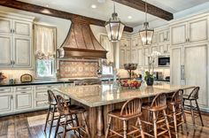 """Kitchen with huge island with seating for at least 6,48"""" Wolf gas stove with double ovens, built in Thermador side by side refrigerator/freezer, two refrigerator drawers, plus many more custom features!"""