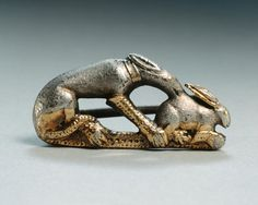 Fibula of a dog catching a rabbit (silver & gilt), Roman, (3rd century AD)