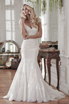 Wedding gown by Maggie Sottero.