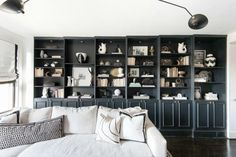 Using a dark color on one wall can trick the eye into thinking the space is wider.