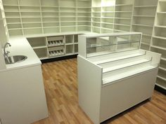 Pharmacy shop layout- pharmacy counters with sink unit and display cupboards. #pharmacyunits #glasscounters #shopcounters #counters