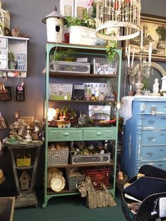 Green metal shelving unit,  love green.  Great for metal baskets to be organized.