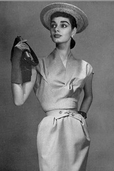 1955 Jacky Mazel in cap-sleeved dress, handbag and day gloves, all by Hermès