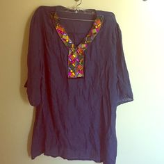 Jeweled Navy Tunic Top Tunic top in navy with multicolored jewels. Thin fabric, More like a cover up weight. I've worn with a sweater over or tank under Tops Tunics