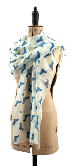 fdf6f7a949 Cashmere and merino scarf with dachshunds. Available from  www.annabeljames.co.uk