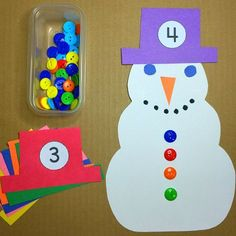 Counting buttons on snowmen! This is a great winter math center for preschool and kindergarten.