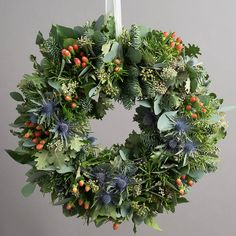highland festive foliage wreath by the flower studio | notonthehighstreet.com