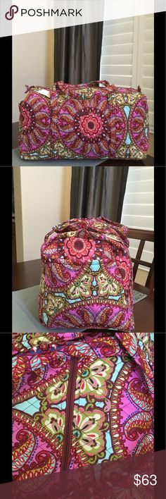 """NWT VERA BRADLEY LARGE DUFFEL Brand new with tags Vera Bradley large duffel  Resort medallion pattern  15"""" strap drop Handy outside end pocket Folds flat for easy storing Dimensions 22"""" W x 11½"""" H x 11½"""" D - 15"""" strap drop Duffle Smoke/pet free home Vera Bradley Bags Travel Bags"""
