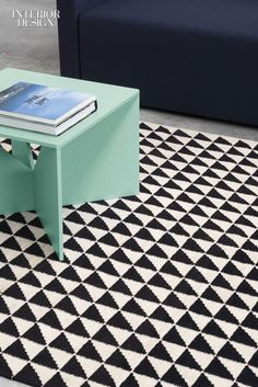 23 Dynamic New Flooring Products to Energize Any Space | Firm: E15 Design und Distributions. Product: Iza. Designer: Philipp Mainzer. Standout: Linked triangles create a contemporary contrast, produced in lamb's wool with the weaving methods traditional for kilims. #design #interiordesign #interiordesignmagazine #products #flooring