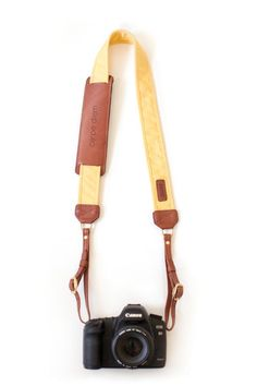 The Golden Fotostrap - a dandelion yellow canvas and leather camera strap!  All Fotostraps are made in the USA, give 10% of proceeds of each sale back to Fotolanthropy, and offer custom monogramming to the leather shoulder pad.  Add your name, initials, monogram, or even a business logo!  Shop at www.fotostrap.com.