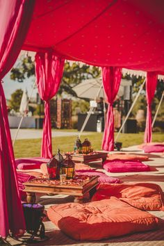 Floor seating with cushions , engagement decor , mehendi decor , orange and purple sangeet decor