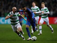 Scott Brown of Celtic (L) and Neymar of Barcelona (R) battle for possession during the UEFA Champions League Group C match between Celtic FC and FC Barcelona at Celtic Park Stadium on November 23, 2016 in Glasgow, Scotland.