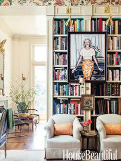 Paintings on the bookshelf. Design: Alex Hitz. housebeautiful.com #bookshelves #library #portraits