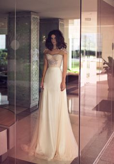 The way the shoulders on this dress just float breathlessly on her shoulders. | 50 Gorgeous Wedding Dress Details That Are Utterly To Die For