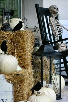 This front porch sitter has been waiting for you (for along time!)… Hay, White Pumpkins, and Scarecrows, what's not to love about these inspiring Halloween porch ideas? More Boo-tiful Porch Halloween Ideas and Patio Inspiration on Frugal Coupon Living. Halloween Porch Decorations, Skeleton Decorations, Halloween Home Decor, Holidays Halloween, Halloween Crafts, Halloween Design, Porch Ideas For Halloween, Halloween Fotos, Scary Halloween