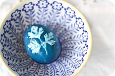 Make your own Herb Stenciled Easter Eggs. Love that deep, deep blue.