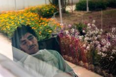 22-year-old Kharim Ahmad during his time at the emergency hospital in Lashkar Gah following shrapnel wounds on his face and the loss of a leg during fighting in Sangin, Afghanistan, 2015, photograph by Paula Bronstein.