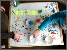 Sticky Table idea. This looks like a lot of fun.  So far though Noah has not interest in sticky things- maybe one day!