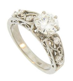 Eventually, we are going to replace my engagement ring and I want it to be in an antique style similar to this. i will need it in yellow gold though, or at least some yellow gold.