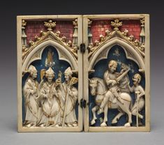 Diptych with Scenes from the Life of Saint Martin of Tours: The Consecration of Saint Martin as Bishop (left); Saint Martin Shares his Cloak with a Beggar, 1340-1350 Germany, Cologne, 14th century ivory with polychromy and gilding, original silver hinges, Overall - h:9.20 cm (h:3 9/16 inches) Closed - w:5.20 cm (w:2 inches).
