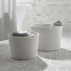 Poly-cotton rope coils multifunctional storage totes in crisp white with inset handles for easy carrying. Basket available in two sizes.<br /><br /><NEWTAG/><ul><li>60% cotton and 40% polyester</li><li>Spot clean</li><li>Made in China</li></ul>