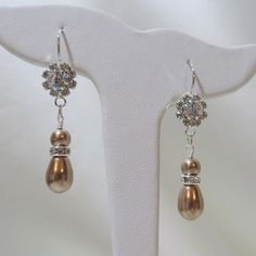 Check out this item in my Etsy shop https://www.etsy.com/listing/110231782/swarovski-bronze-teardrop-pearl
