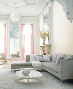 neutral living space with a pop of pink